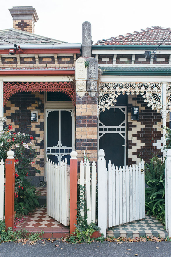 Two gates open to adjoining single-storey terrace houses