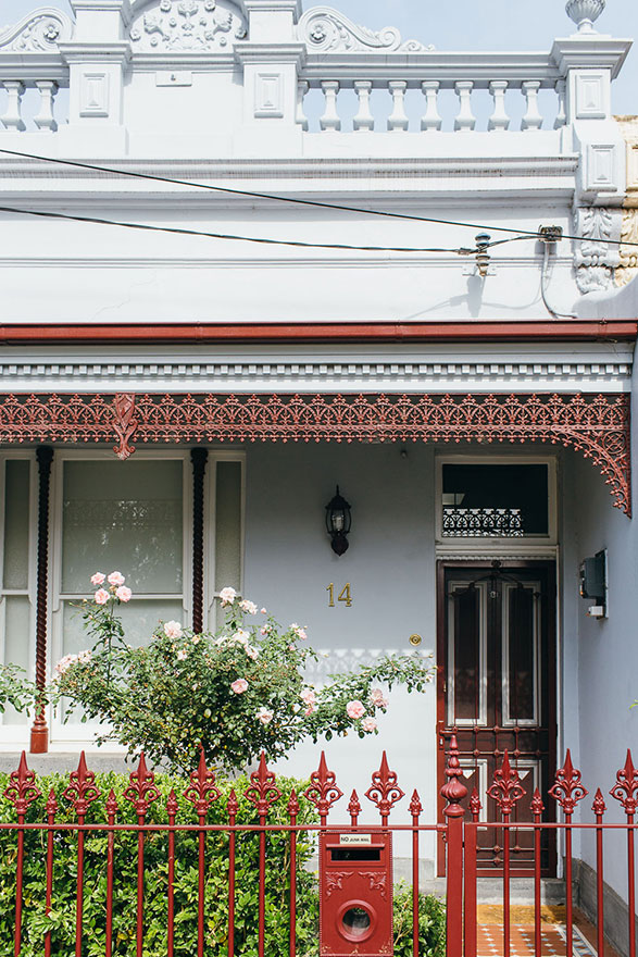 Pale blue terrace house with burgundy detailing