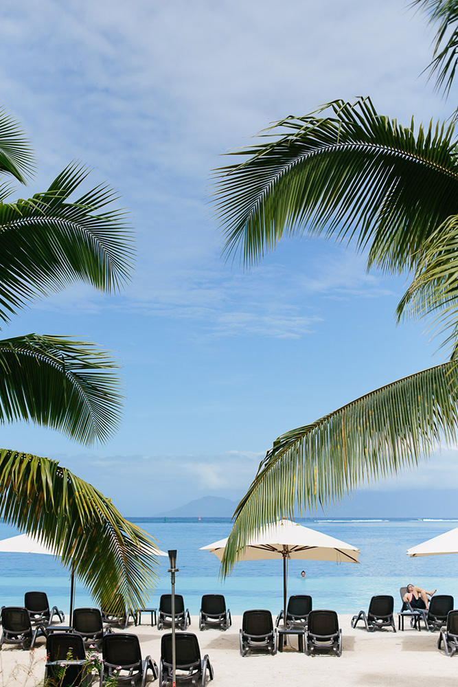 Infinity pool into a blue sky at a resort in Tahiti