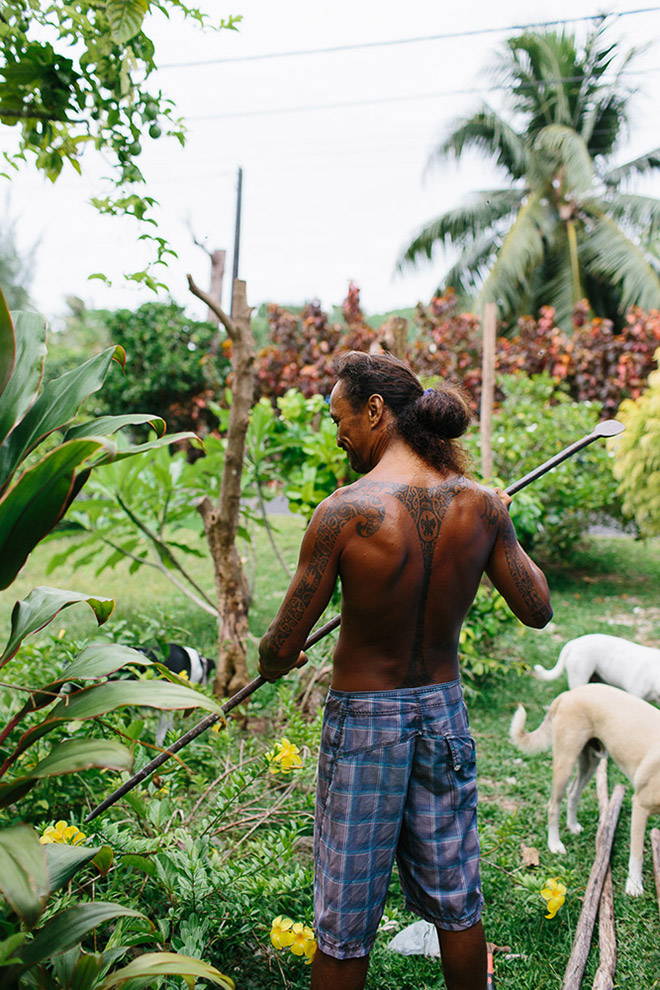 Tattoos on a local Tahitian man's back represent his life