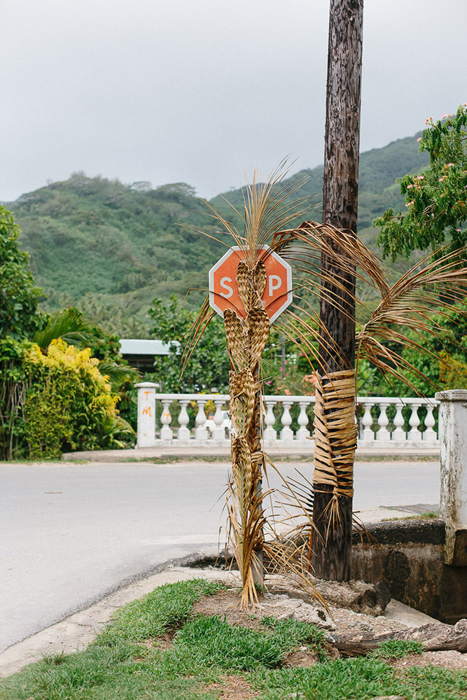 Stop sign decorated with weaving