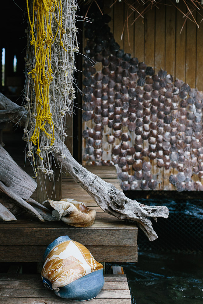 Pearl farm details with ceramics and shells