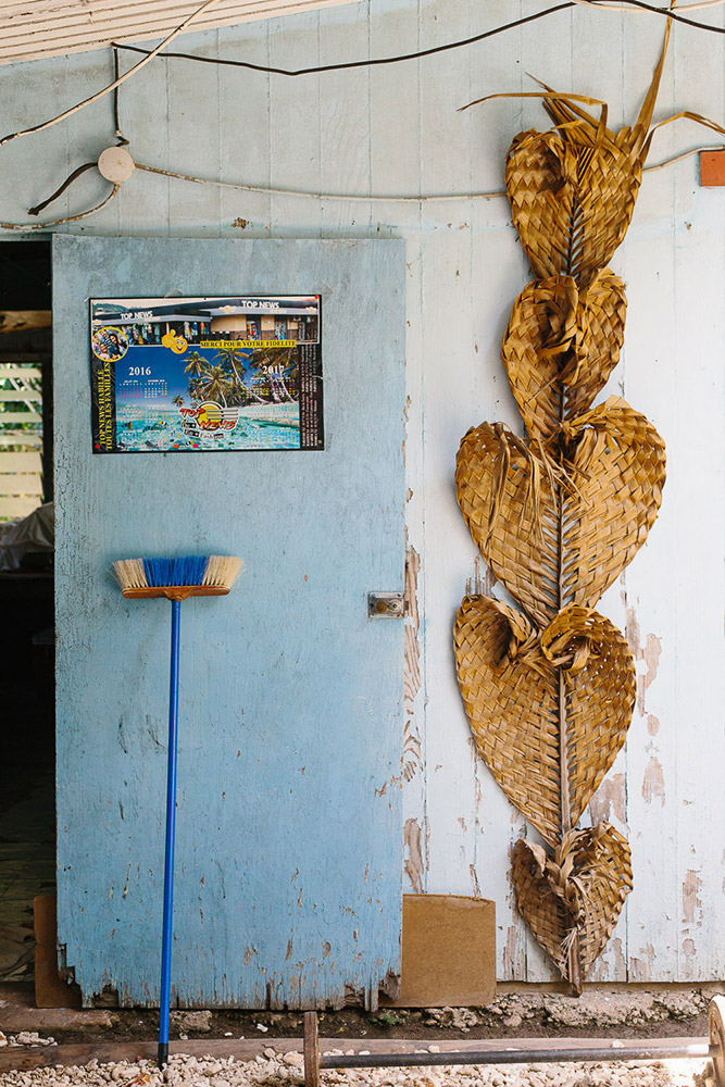 Traditional weaving hangs at the door of someones home in Huahine