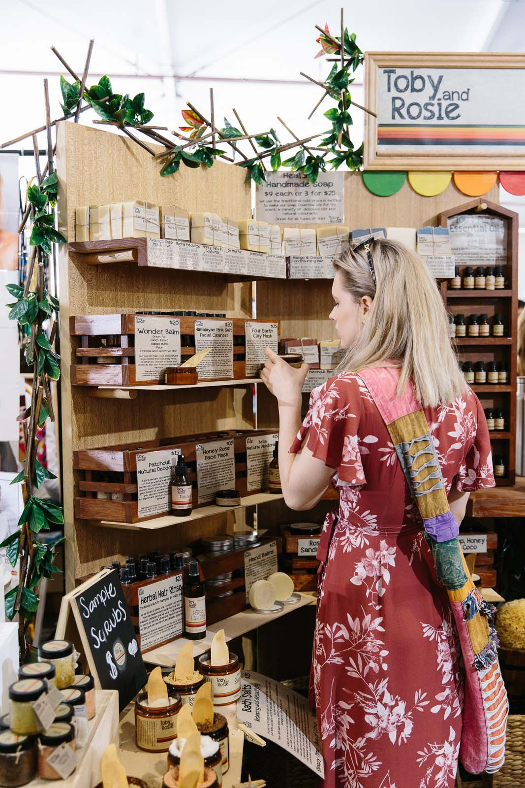 Woman shopping for organic skincare at markets