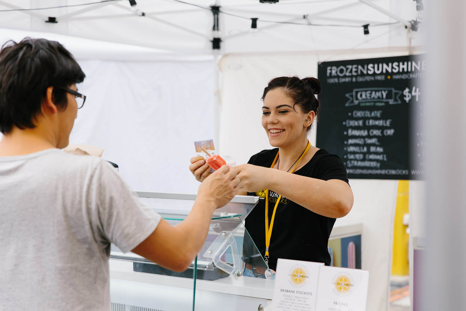 Transaction exchange between customer and stallholder at market
