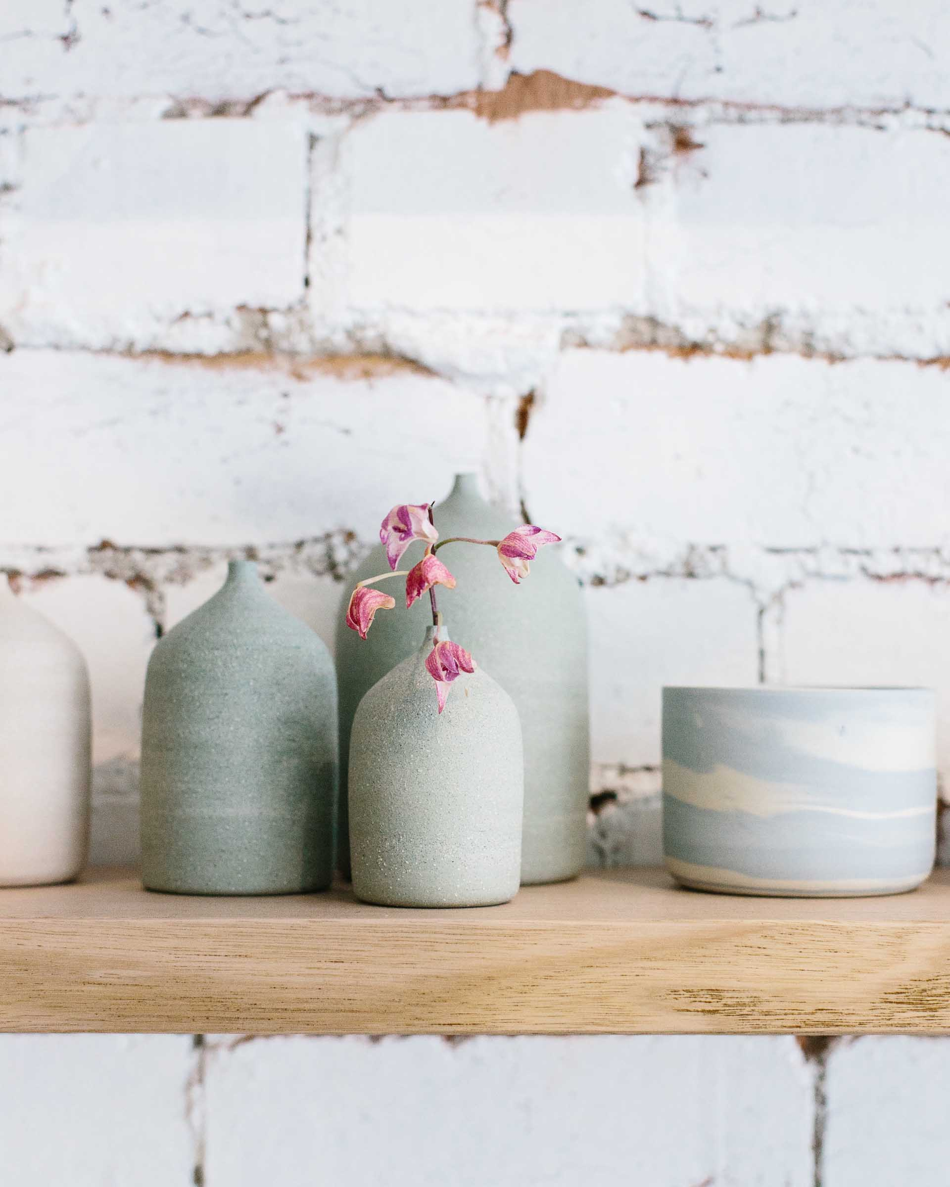 Bud vases by local Melbourne ceramicist in pastel blues