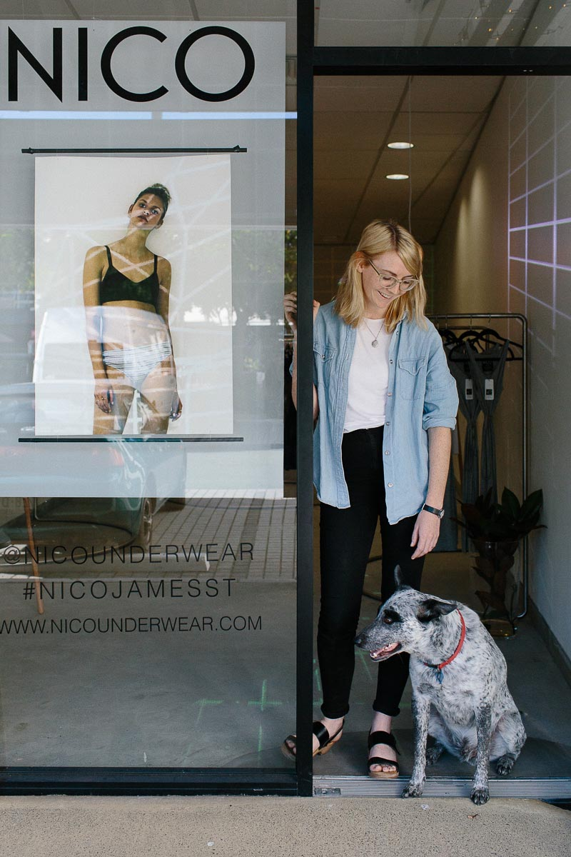 Portrait of Lis Harvey with her dog outside of NICO pop up shop