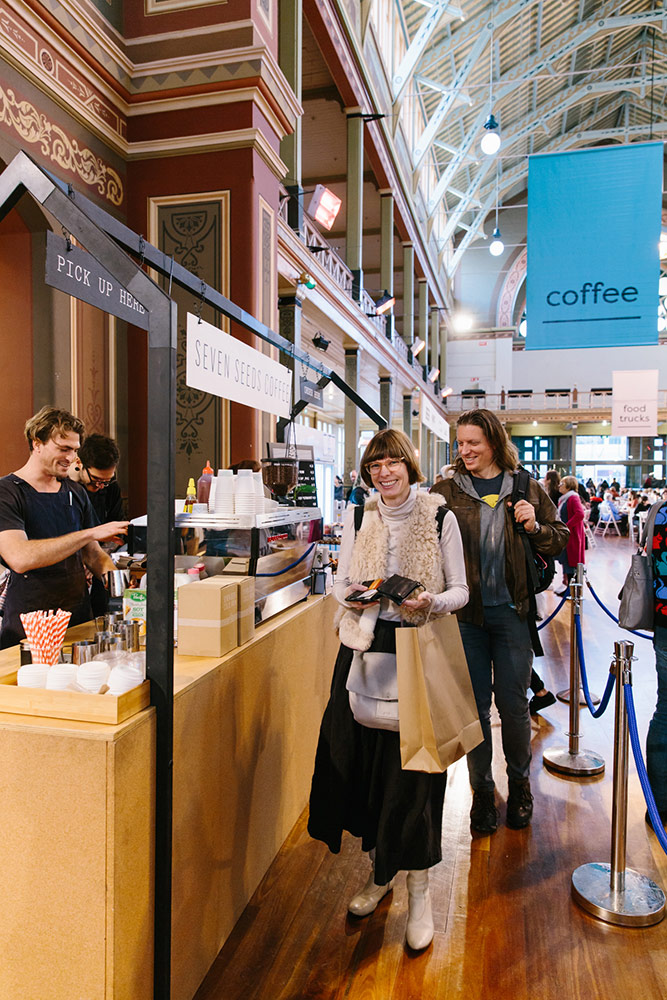 Market goers line up to order coffee