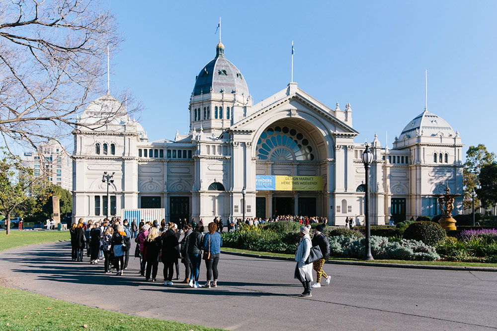 Market goers line up outside the Royal Exhibition Building in Carlton Melbourne for the Finders Keepers Market