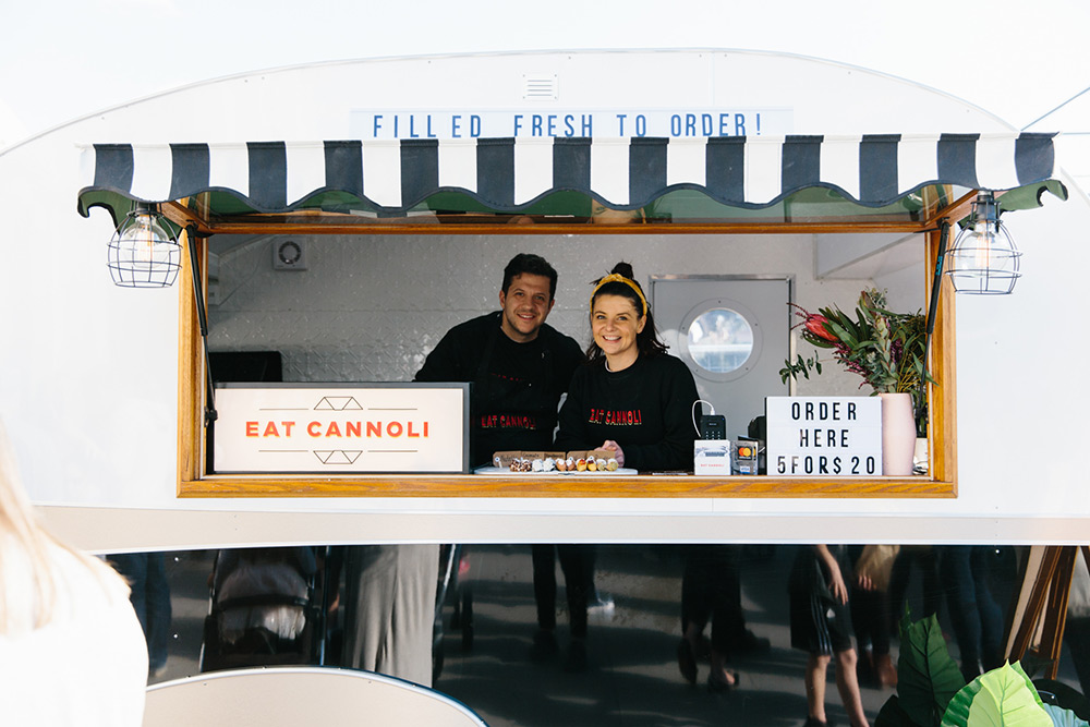 Food truck sellers smile for a photo