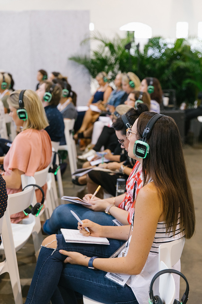 Headphones used by workshop attendees as a silent area, listening to the speaker in an open space