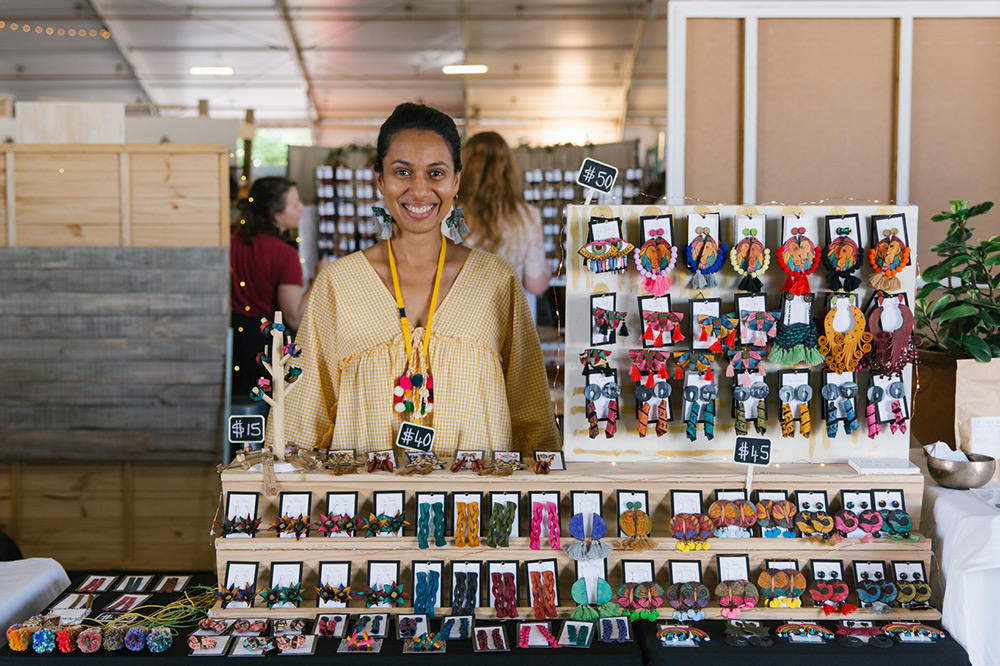 Stallholder smiles with her handmade jewellery