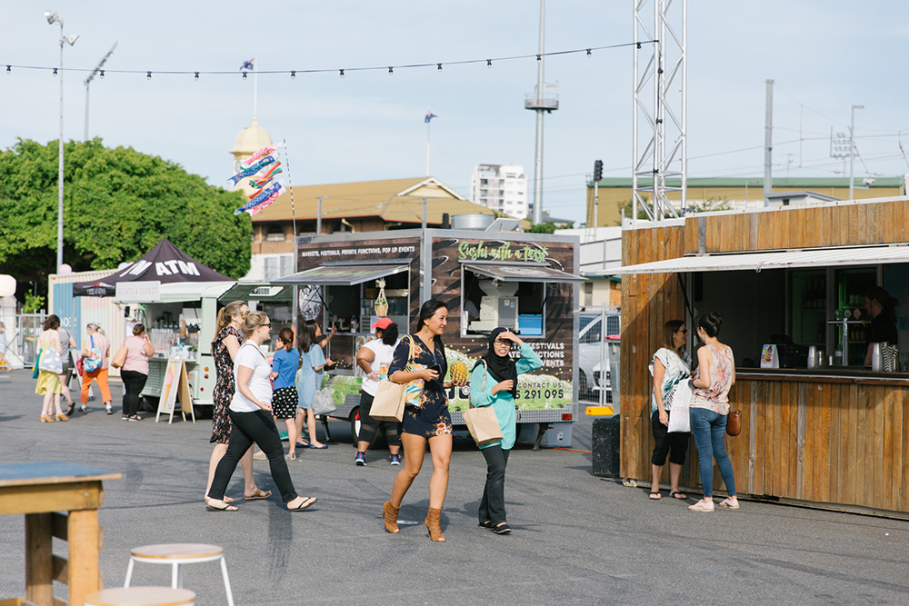 Market goers wander around the Brisbane Showgrounds deciding what food to try