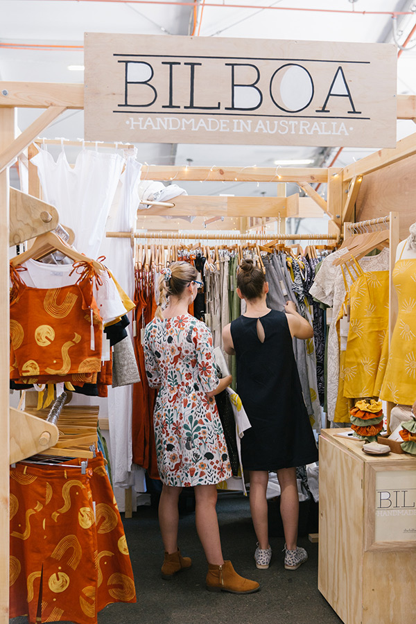 Customers look through the Bilboa stall of handmade clothing from Byron Bay