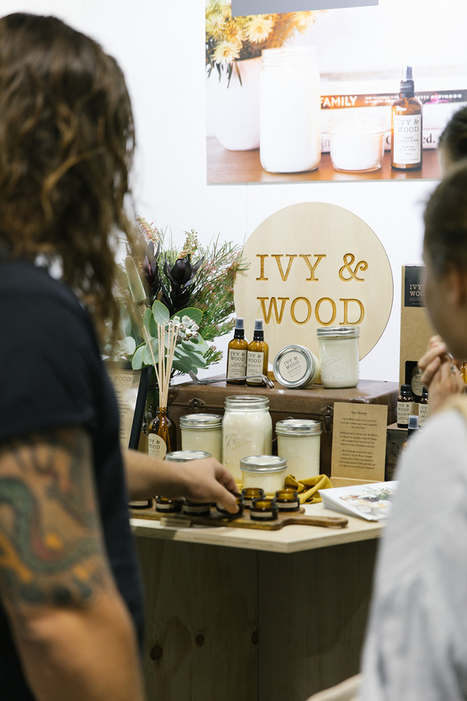 Customers look at Ivy and Wood stall of products