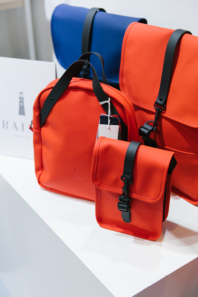 Rains waterproof bags and backpacks in bright red