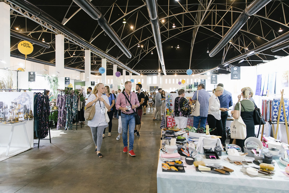 Customers look at stalls at the Life Instyle trade show in Sydney, Australia