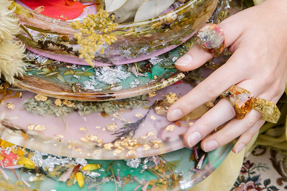 Close up of resin plates with botanical pieces set inside