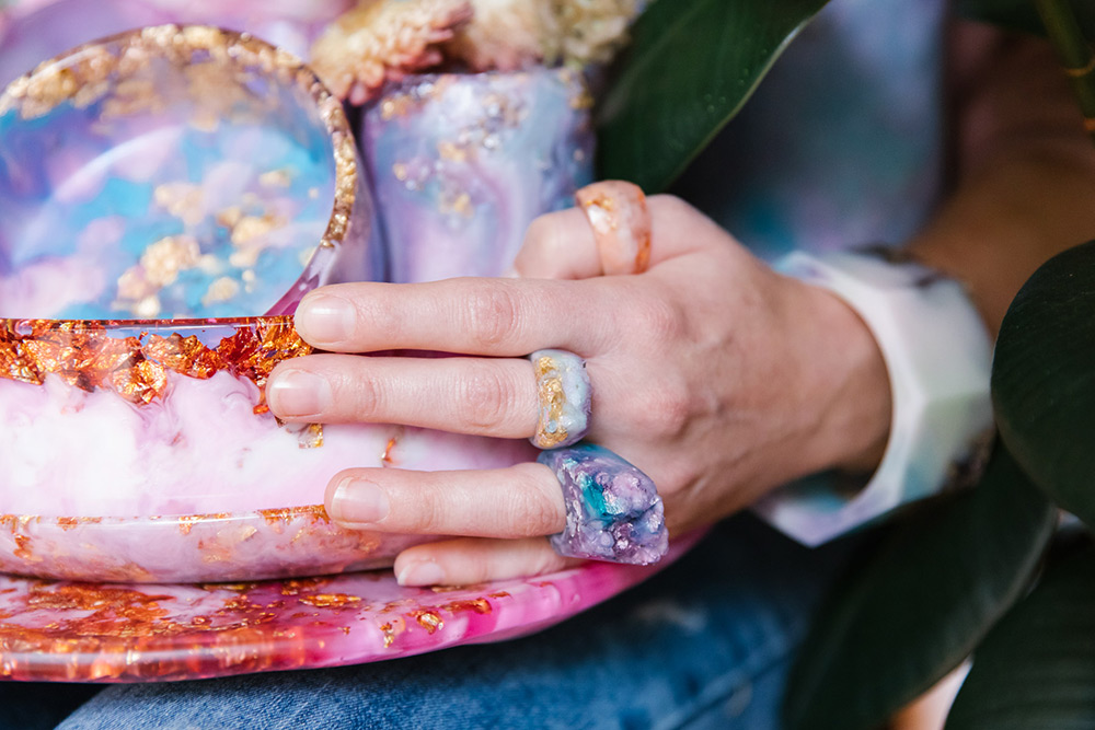 Vibrant resin jewellery and homewares in pinks, purples and blues