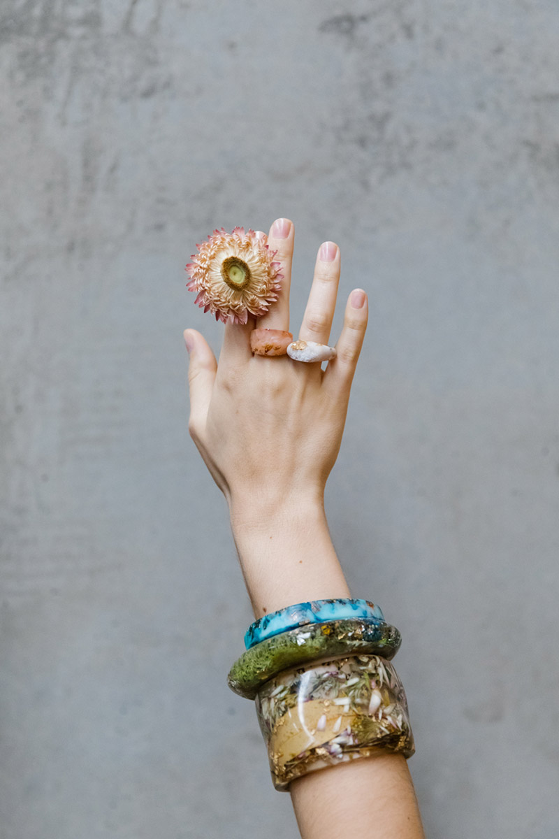 Hand with rings, bangles and flowers