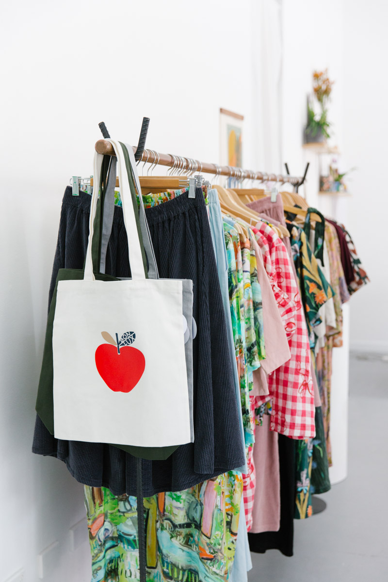 Screenprinted tote bag with bright red apple on the front by Melbourne brand Bon Luxe