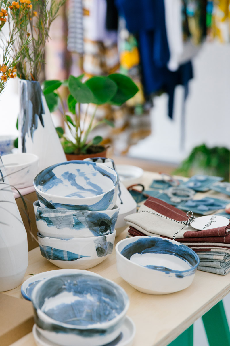 Handmade and hand painted porcelain bowls with blue swishes of paint