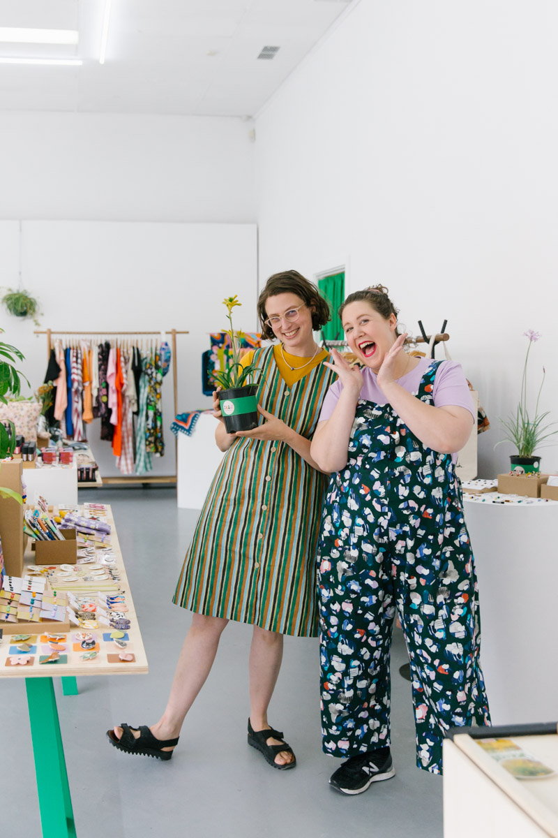 An excitable portrait of Esther and Nat at PALS Pop Up shop